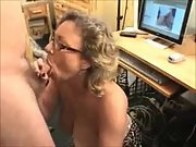 Nerdy mature slut with thick tits sucking a stiff man rod