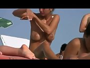 Phenomenal big boobed brunette enjoying being topless at the beach in romania