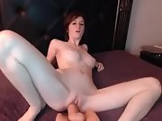 Chesty ginger-haired boinking a ample dildo on the cam