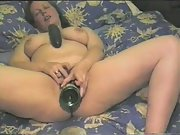 A wine bottle and a cucumber bring on an ejaculation